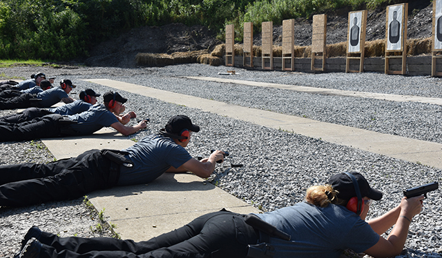 Police academy cadets using the range
