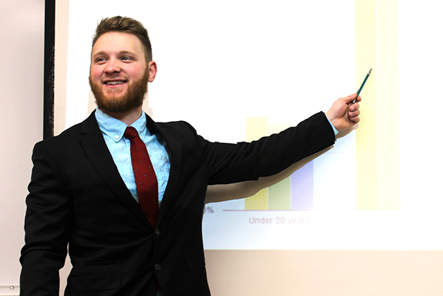 Business student doing presentation in class