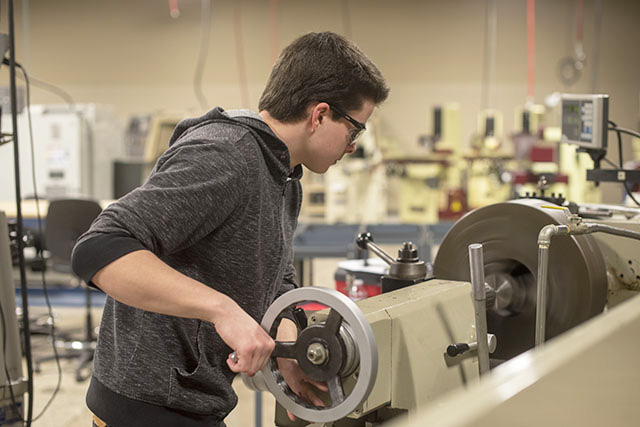 Student completing a Journeyman Machining certificate as part of the ndustrial Technology program