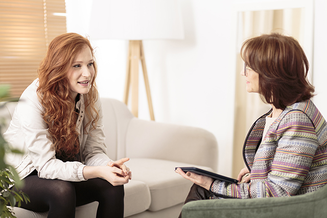 Psychologist with young woman