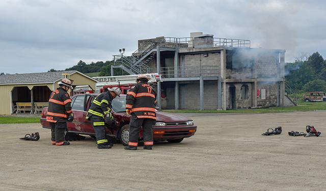 Firefighters demonstrate vehicle rescue techniques at the PSTC. The center offers these courses.