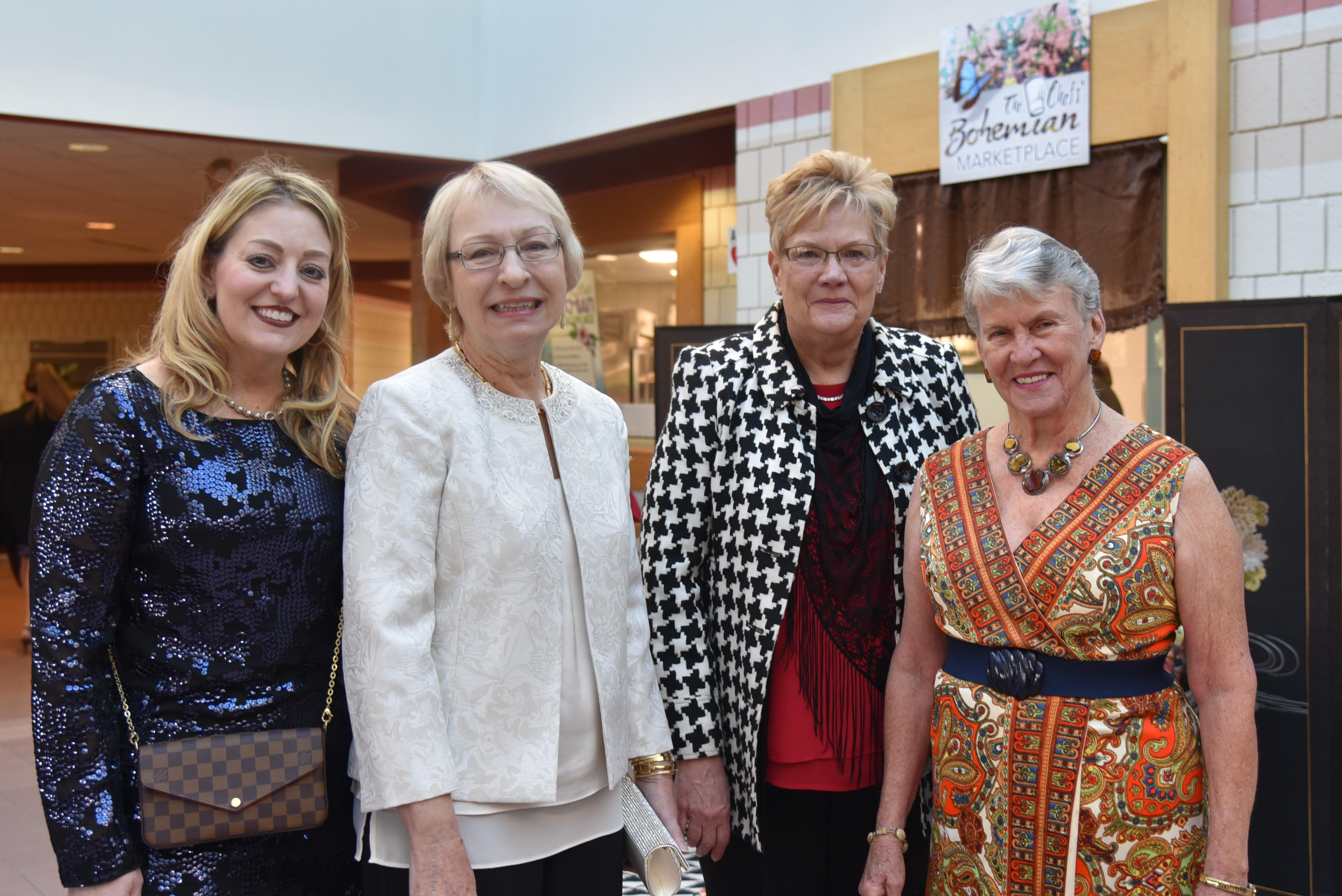 Among the guests enjoying  The Chefs' Marketplace were (from left): Marcy Sloneker, foundation board member; Bridget Johnston, college trustee and foundation board member; Debra Woods, executive director, Westmoreland Educational Foundation; and Dr. Barbara Ferrier, college trustee.