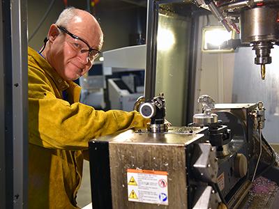 Dane Shultz inside the machine shop at the Advanced Technology Center