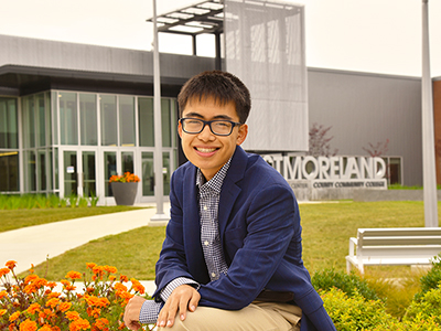David An sits in front of the Student Achievement Center on Westmoreland's Youngwood campus.