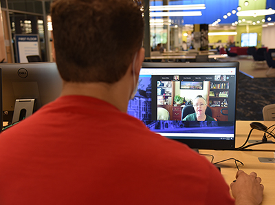 Student using Zoom to take an online class